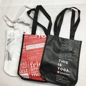 A set of three Lululemon shopping/reusable Bags